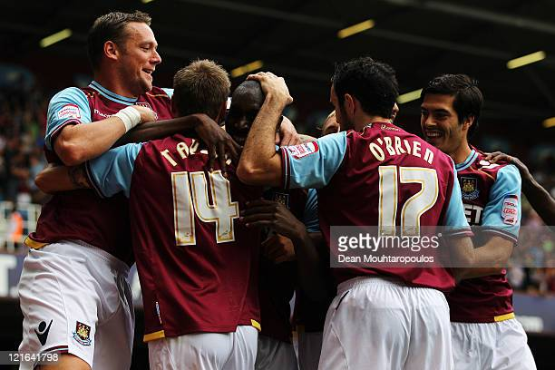 Carlton Cole of West Ham is congratulated by team mates after he scores the first goal of the game during the npower Championship match between West...