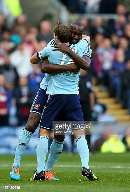 Carlton Cole of West Ham is congratulated by teammate Mark Noble after scoring his team's third goal during the Barclays Premier League match between...