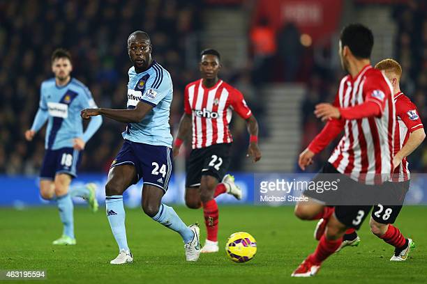 Carlton Cole of West Ham passes the ball during the Barclays Premier League match between Southampton and West Ham United at St Mary's Stadium on...