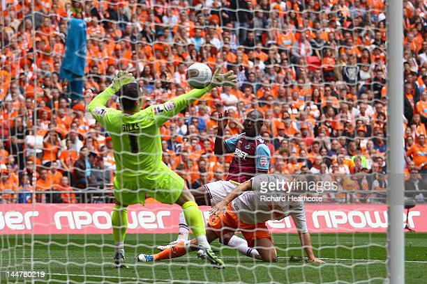 Carlton Cole of West Ham scores the opening goal during the npower Championship Playoff Final between West Ham United and Blackpool at Wembley...