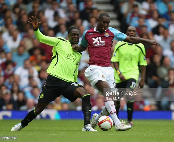 Carlton Cole of West Ham United and Mario Melchiot of Wigan Athletic in action during the Barclays Premier League match between West Ham United and...