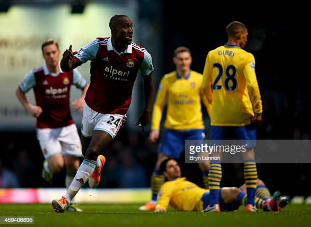 Carlton Cole of West Ham United celebrates as he scores their first goal during the Barclays Premier League match between West Ham United and Arsenal...