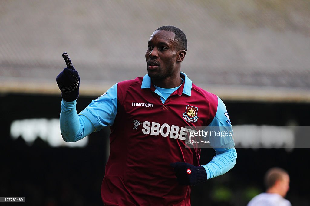 Carlton Cole of West Ham United celebrates as he scores their third goal during the Barclays Premier League match between Fulham and West Ham United at Craven Cottage on December 26, 2010 in London, England.