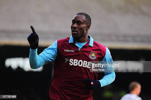 Carlton Cole of West Ham United celebrates as he scores their third goal during the Barclays Premier League match between Fulham and West Ham United...