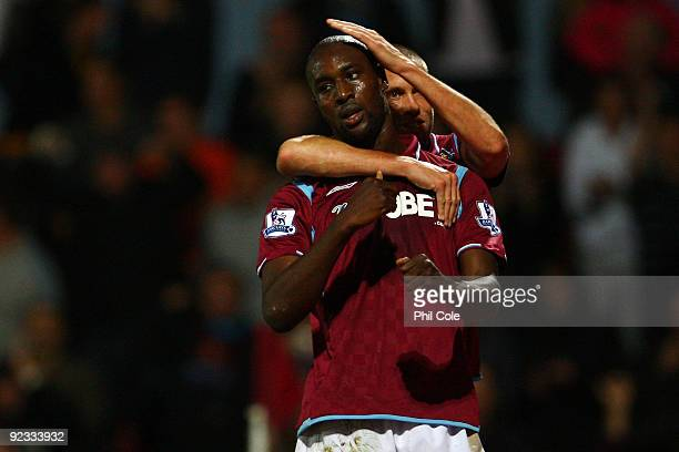 Carlton Cole of West Ham United celebrates scoring during the Barclays Premier League match between West Ham United and Arsenal at Boleyn Ground on...
