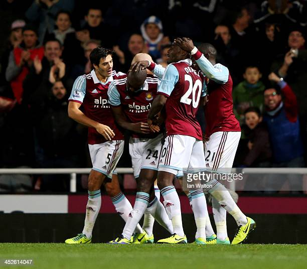 Carlton Cole of West Ham United celebrates with team mates as he scores their second goal during the Barclays Premier League match between West Ham...