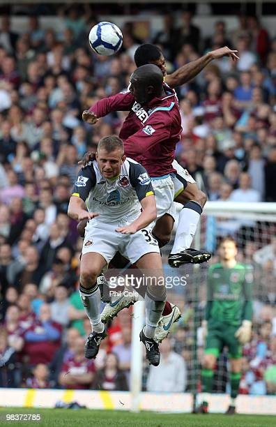 Carlton Cole of West Ham United gets sandwiched between Lee Catermole and Paulo Da Silva of Sunderland during the Barclays Premier League match...