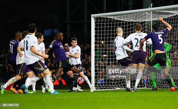 Carlton Cole of West Ham United scores their second goal during the FA Cup Third Round Replay match between West Ham United and Everton at Boleyn...