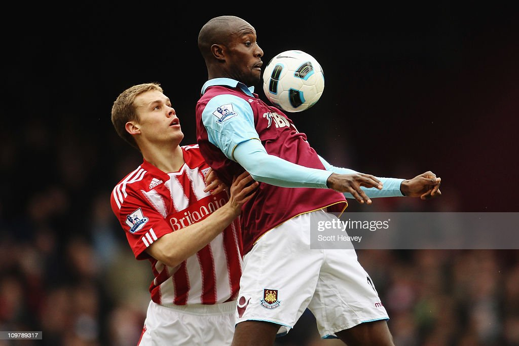 Carlton Cole (R) of West Ham United shields the ball from Ryan Shawcross (L) of Stoke City during the Barclays Premier League match between West Ham United and Stoke City at the Boleyn Ground on March 5, 2011 in London, England.