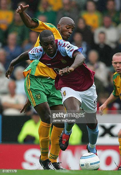 Carlton Cole slips the tackle of Damien Francis of Norwich during the Barclays Premiership match between Norwich City and Aston Villa on September 18...