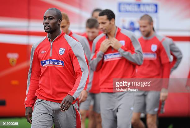 Carlton Cole walks out with team mates before the England training session at London Colney on October 6, 2009 in St Albans, England.