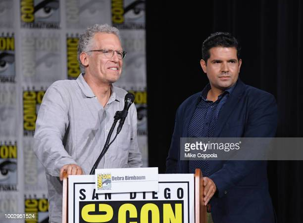Carlton Cuse and Graham Roland speak onstage at the Amazon Prime Video Showcase during ComicCon International 2018 at San Diego Convention Center on...