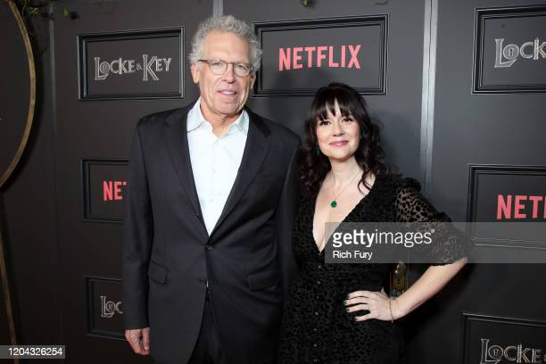 Carlton Cuse and Meredith Averill attend Netflix's Locke Key series premiere photo call at the Egyptian Theatre on February 05 2020 in Hollywood...