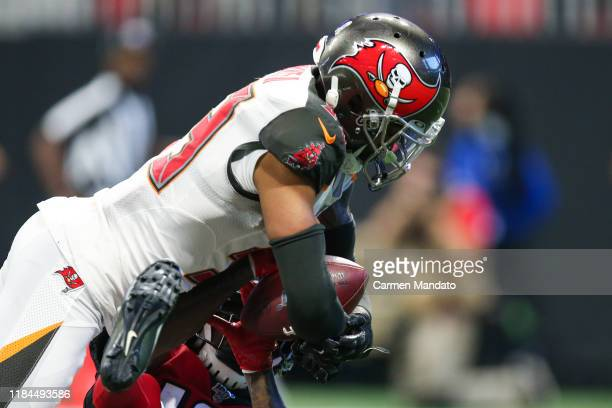 Carlton Davis of the Tampa Bay Buccaneers intercepts a ball intended for Calvin Ridley of the Atlanta Falcons during the second half of a game at...