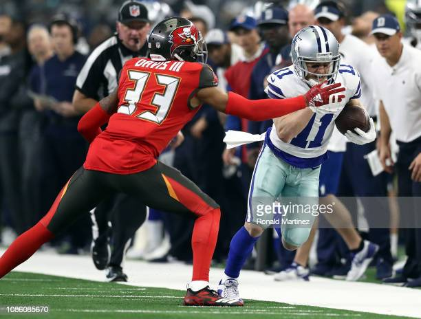 Carlton Davis of the Tampa Bay Buccaneers tries to stop the run by Cole Beasley of the Dallas Cowboys in the third quarter at ATT Stadium on December...