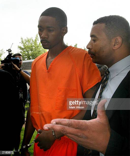 Carlton Dotson walks with his attorney Purcel Luke as he arrives at the Kent County district court house July 22 2003 in Chestertown Maryland The...