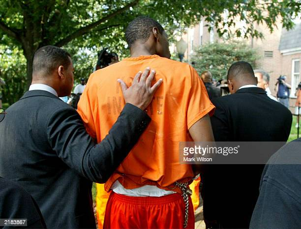 Carlton Dotson walks with his attorney Sherwood Wescott and Purcel Luke as he arrives at the Kent County district court house July 22 2003 in...