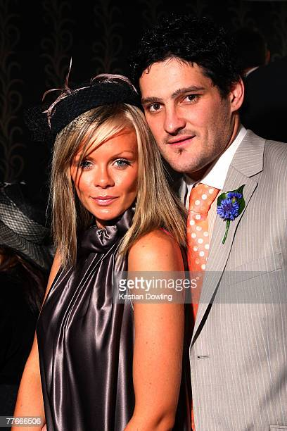 Carlton FC player Brendan Fevola and wife Alex pose together at the Andrew McManus Marquee on the first day of the Melbourne Cup Carnival Derby Day...