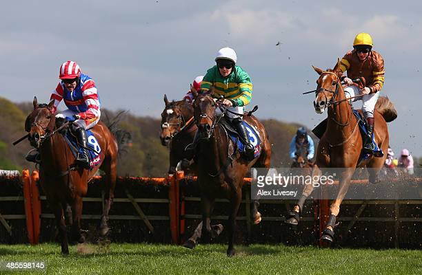 Carlton Jack ridden by Maurice Linehan jumps the last fence ahead of Heath Hunter ridden by Tom Scudamore and Generous Ransom ridden by Jamie Moore...