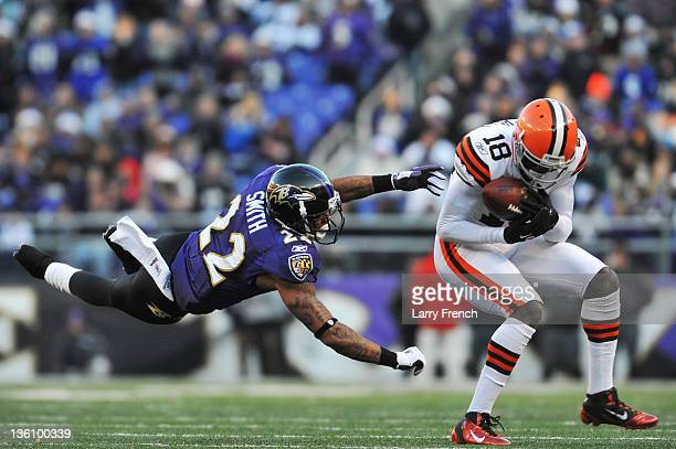 Carlton Mitchell of the Cleveland Browns makes this catch while Jimmy Smith of the Baltimore Ravens defends at MT Bank Stadium on December 24 2011 in...