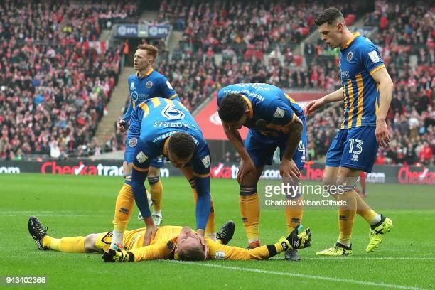 Carlton Morris, Ben Godfrey and James Bolton of Shrewsbury check on their unconscious goalkeeper Dean Henderson during the Checkatrade Trophy Final...