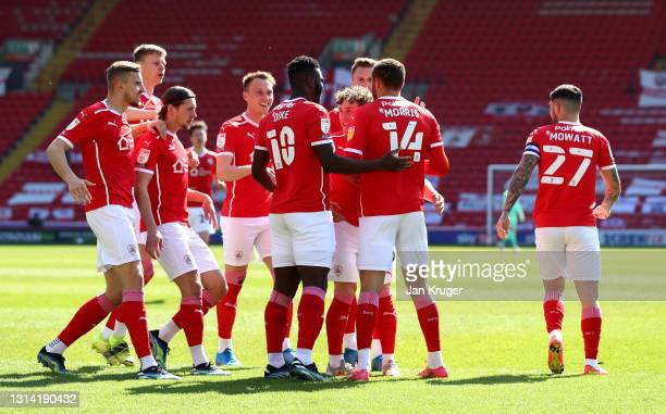 Carlton Morris of Barnsley celebrates after scoring their sides first goal with team mate Daryl Dike during the Sky Bet Championship match between...