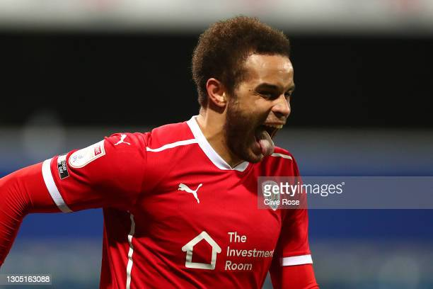 Carlton Morris of Barnsley celebrates after scoring their side's third goal during the Sky Bet Championship match between Queens Park Rangers and...