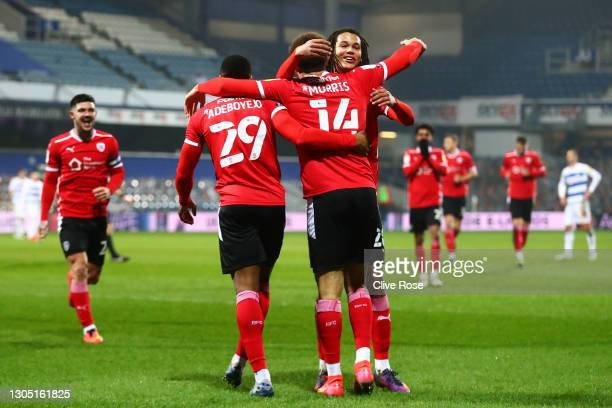 Carlton Morris of Barnsley celebrates with Victor Adeboyejo and Toby Sibbick after scoring their side's third goal during the Sky Bet Championship...