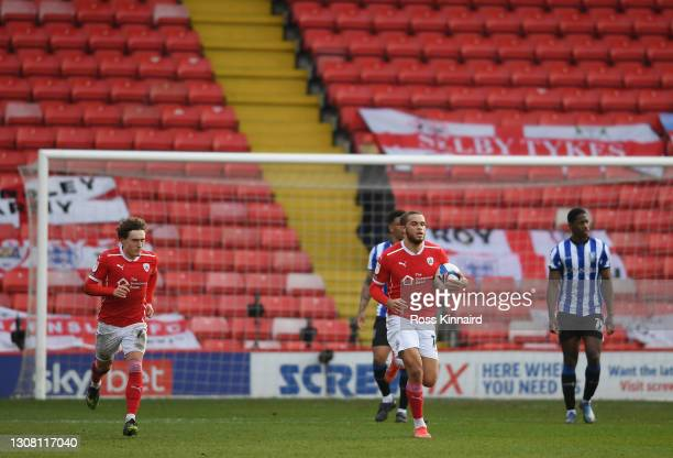 Carlton Morris of Barnsley FC celebrates after scoring their team's first goal during the Sky Bet Championship match between Barnsley and Sheffield...