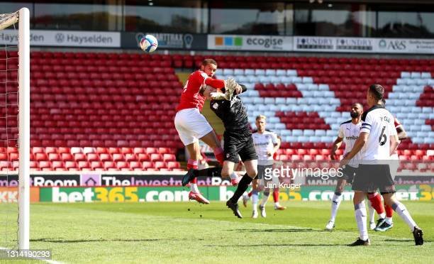 Carlton Morris of Barnsley scores their sides first goal past Viktor Johansson of Rotherham United during the Sky Bet Championship match between...
