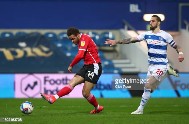 Carlton Morris of Barnsley scores their sides third goal during the Sky Bet Championship match between Queens Park Rangers and Barnsley at The Kiyan...