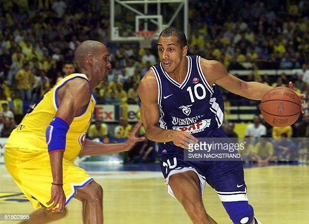 Carlton Myers of Paf Bologna works his way past Ariel McDonald of Maccabi Tel Aviv in the third and decisive European Champions League quarterfinal...