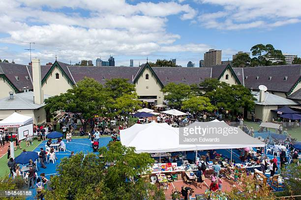 Marquees and crowds gather at an inner city school fete fundraiser.