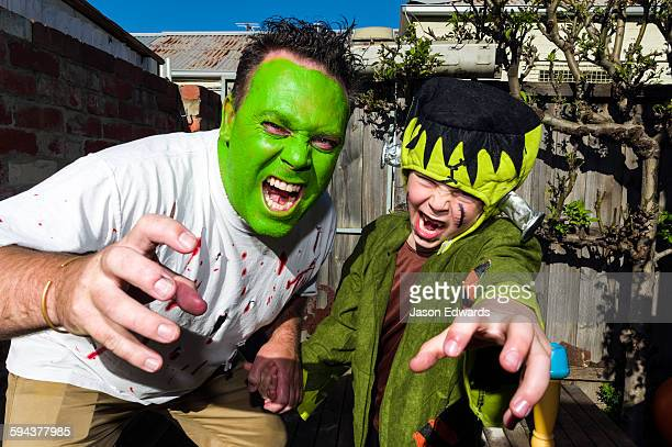 A dad and his son, attack the camera at a monster party.