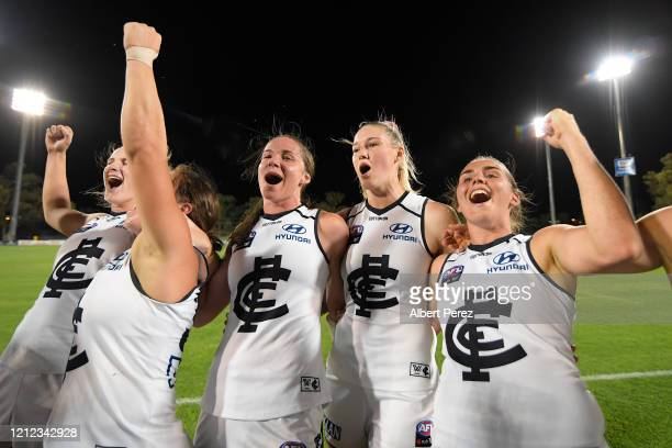Carlton players sing the club anthem after their victory in the round six AFLW match between the Melbourne Demons and the Carlton Blues at TIO...