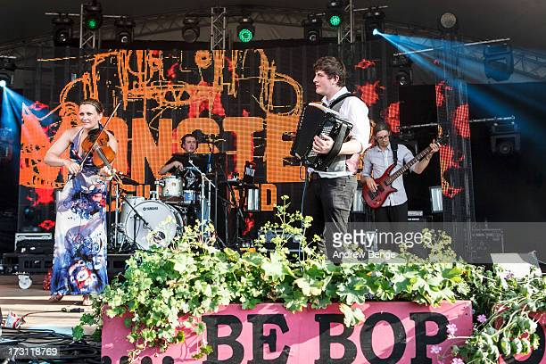 Carly Blain David de la Haye and Joe Truswell of Monster Ceilidh Band perform on stage on Day 3 of Beatherder Festival 2013 at Ribble Valley on July...