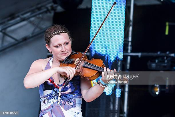 Carly Blain of Monster Ceilidh Band performs on stage on Day 3 of Beatherder Festival 2013 at Ribble Valley on July 6 2013 in Clitheroe England