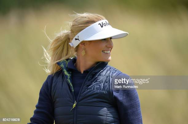 Carly Booth of Scotland all smiles as she walks from the 2nd green during the third day of the Aberdeen Asset Management Ladies Scottish Open at...