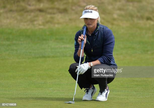 Carly Booth of Scotland lines up a putt at the 1st hole during the third day of the Aberdeen Asset Management Ladies Scottish Open at Dundonald Links...