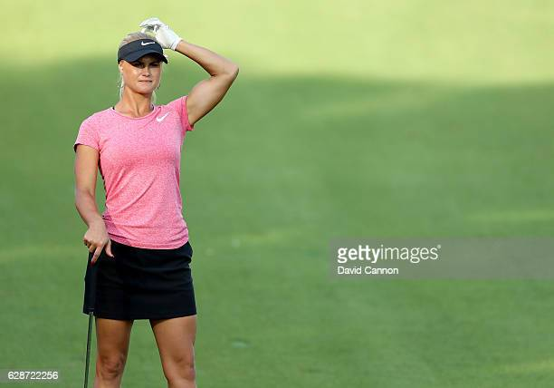 Carly Booth of Scotland waits to play her second shot at the 14th hole during the delayed second round of the 2016 Omega Dubai Ladies Masters on the...