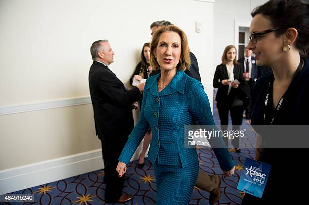 Carly Fiorina, former CEO of Hewlett-Packard, walks the hallway before her speech at CPAC in National Harbor, Md., on Feb. 26, 2015.