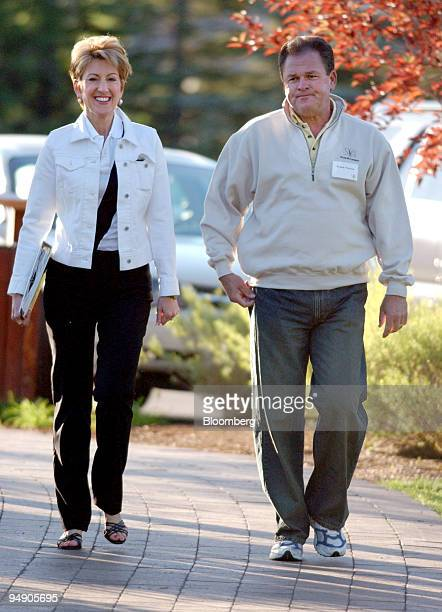 Carly Fiorina left CEO HewlettPackard Company walks with a man identified as Frank Fiorina at the Allen Co conference in Sun Valley Idaho July 7 2004