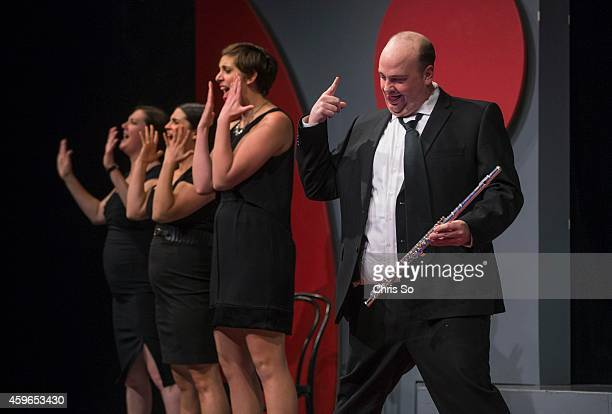 Carly Heffernan Ashley Botting Allison Price and Marty Adams do a convincing skit to portray that the flute can have the same rock star status as an...