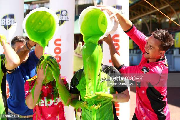 Carly Leeson of the Sixer and Maisy Gibson of the Thunder are slimed by Lee Carseldine and Stephen O'Keefe of the Sixers during the KFC BBL Renewal...