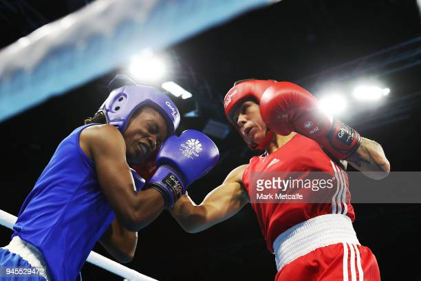 Carly McNaul of Northern Ireland and Christine Ongare of Kenya compete in their Women's Fly 4851kg Semifinal bout during Boxing on day nine of the...