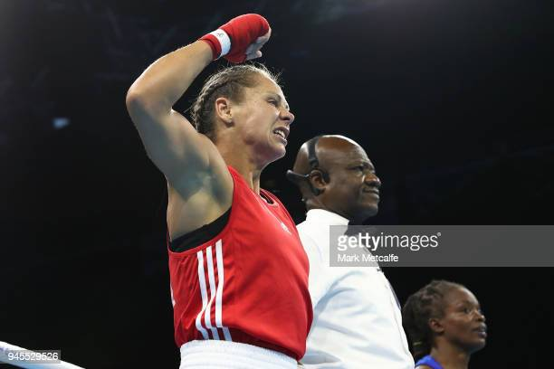 Carly McNaul of Northern Ireland celebrates winning her Women's Fly 4851kg Semifinal bout against Christine Ongare of Kenya during Boxing on day nine...