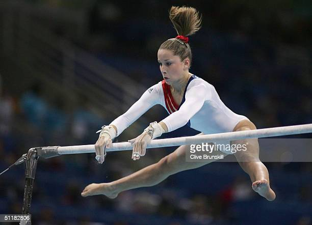 Carly Patterson of of the United States competes on the uneven bars at the women's artistic gymnastics team final uneven on August 17 2004 during the...
