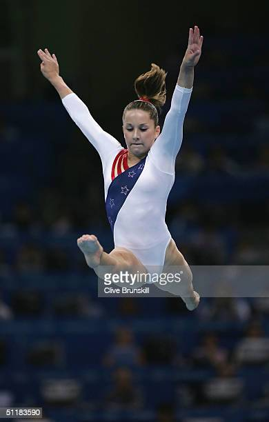 Carly Patterson of the United States competes in the beam in the women's artistic gymnastics team final uneven on August 17 2004 during the Athens...