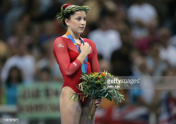 Carly Patterson of the United States wins gold in the Women's Individual AllAround in the Olympic Indoor Hall at the Athens 2004 Olympic Games in...