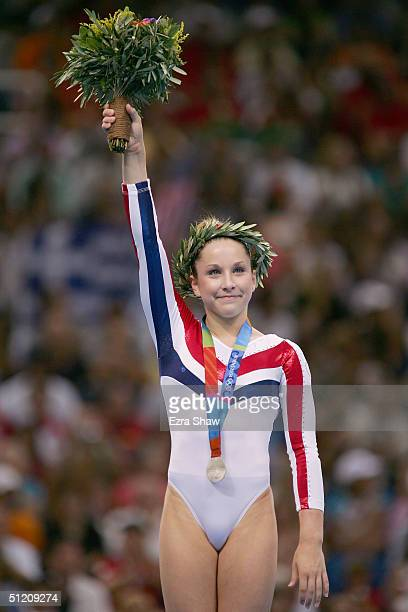 Carly Patterson of United States receives the silver medal for the women's artistic gymnastics balance beam event on August 23 2004 during the Athens...